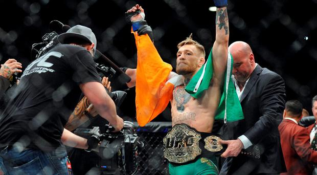 Conor McGregor is declared the winner by knockout and crowned champion against Jose Aldo during UFC 194 at MGM Grand Garden Arena. Credit: Gary A. Vasquez-USA TODAY Sports