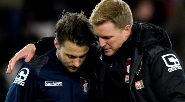 Bournemouth's Harry Arter with manager Eddie Howe, pictured after the loss of his daughter