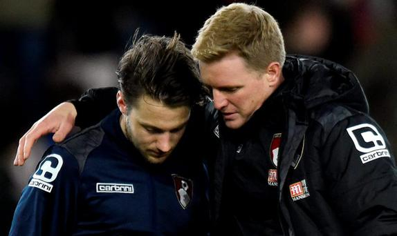 Bournemouth's Harry Arter with manager Eddie Howe after the game Reuters / Toby Melville