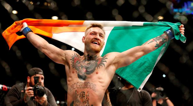 Conor McGregor reacts after defeating Jose Aldo during a featherweight championship mixed martial arts bout at UFC 194, Saturday, Dec. 12, 2015, in Las Vegas. (AP Photo/John Locher)