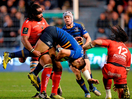Ben Te'o is held up by Mathieu Bastareaud at the Stade Felix Mayol. Picture credit: Seb Daly / SPORTSFILE