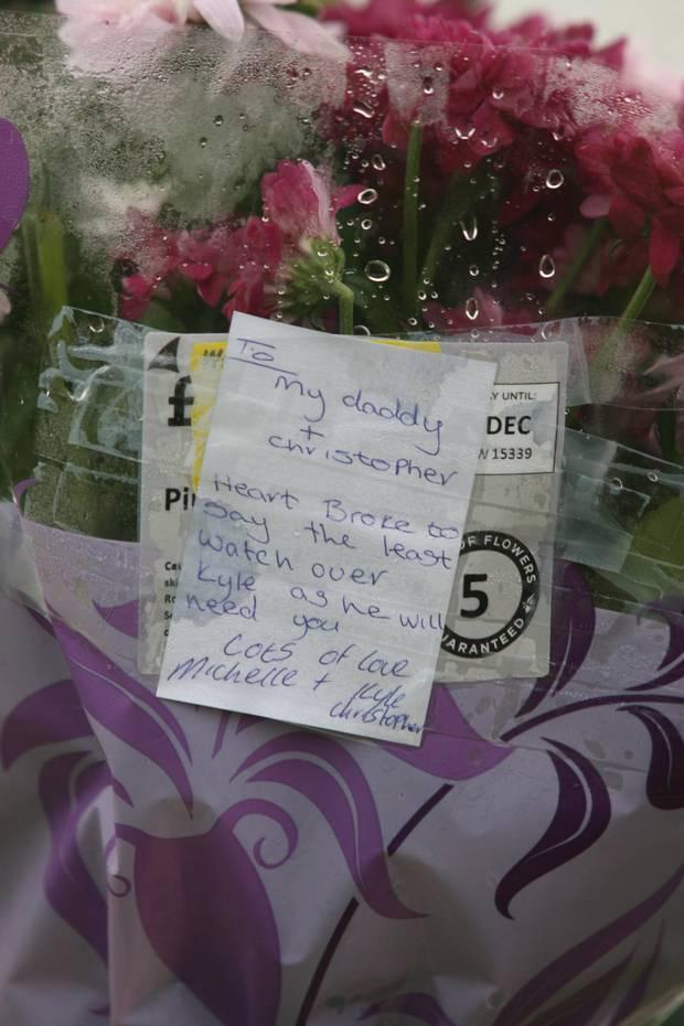 Flowers left at the scene of the murder of Christopher Meli at Glasvey Close in west Belfast. Pic: Matt Bohill/Pacemaker.