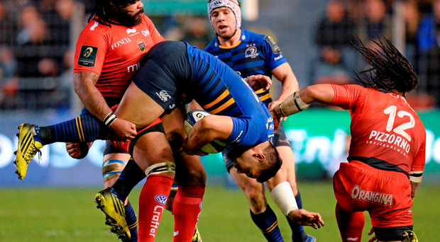 Leinster's Ben Te'o is held up by Toulon's Mathieu Bastareaud during their Champions Cup clash at the Stade Felix Mayol