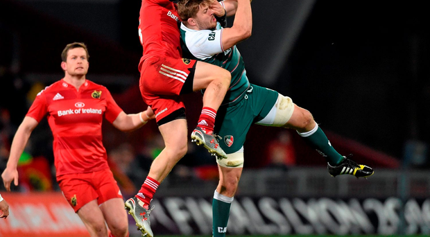 Munster full-back Andrew Conway contests a high ball with Ed Slater of Leicester at Thomon Park on Saturday