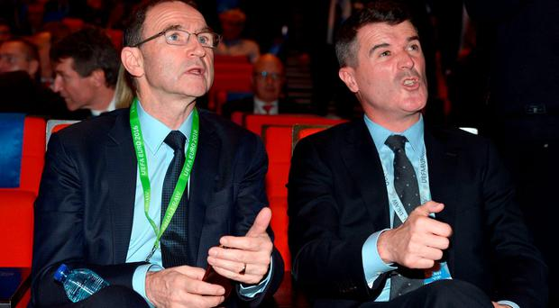 Martin O'Neill and Roy Keane react as the countries are drawn for Group E on Saturday night ADAM DAVY/PA