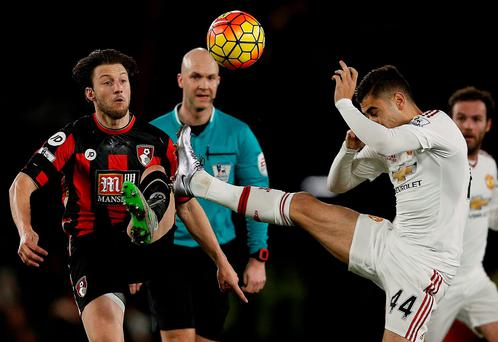 Harry Arter battles it out with Manchester United's Andreas Pereira