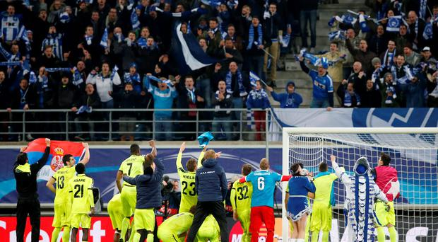 Gent players celebrate with fans following their victory against Zenit St. Petersburg