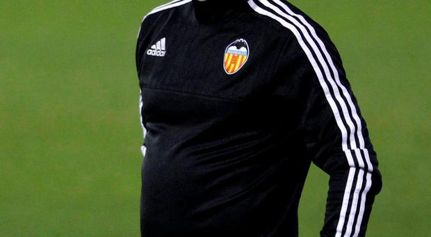 Gary Neville's Valencia had a man sent off and needed an Eibar own goal to rescue a 1-1 draw