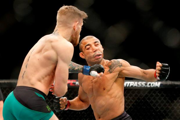 Conor McGregor floors Jose Aldo with a left-hook