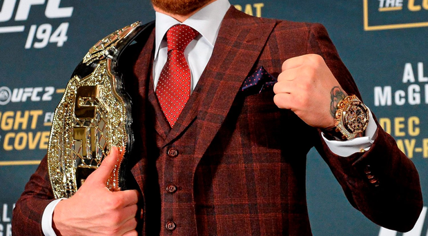 Conor McGregor shows off his UFC featherweight title belt