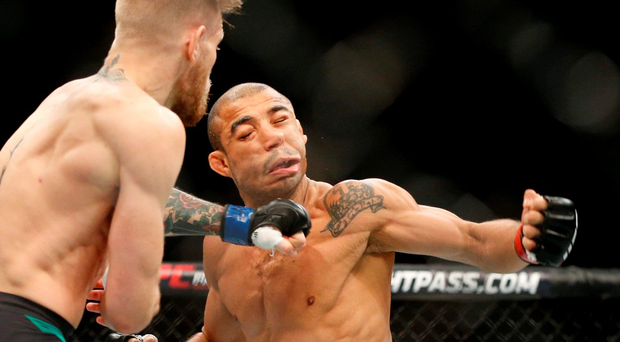 McGregor lands the telling left hook on Jose Aldo