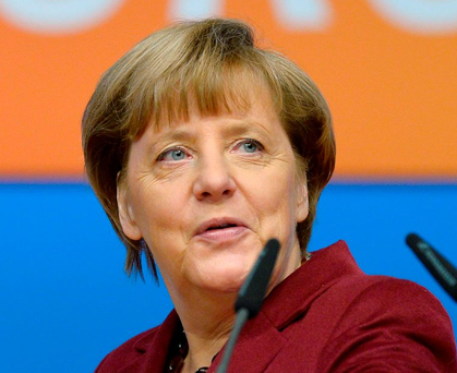 German Chancellor and Christian Democratic Union (CDU) leader Angela Merkel inspects the location for the CDU's party congress in Karlsruhe, southwestern Germany, on December 13, 2015. German Chancellor Angela Merkel will seek at her party's congress to stamp out dissent in her conservative Christian Democratic Union over a record refugee influx after months of corrosive infighting. AFP PHOTO / THOMAS KIENZLETHOMAS KIENZLE/AFP/Getty Images