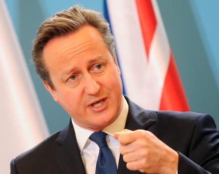 British Prime Minister David Cameron speaks during a press conference after talks with his Polish counterpart Beata Szydlo in Warsaw, Poland, Thursday, Dec. 10, 2015. Cameron came to Poland to discuss his plans for having a reform of the EU, fight against extremists and also issues concerning some two million Poles living in Britain. (AP Photo/Alik Keplicz)