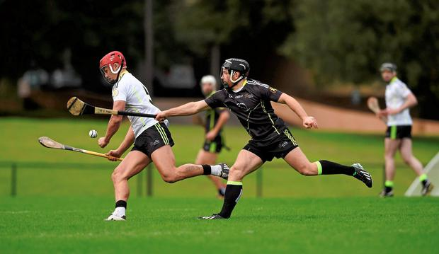 Lee Chin, 2014 All-Stars, in action against Richie Hogan, 2015 All-Stars. GAA All-Star Tour 2015, sponsored by Opel, 2014 All-Stars v 2015 All-Stars. St Edward's University, Austin, Texas, USA. Picture credit: Ray McManus / SPORTSFILE