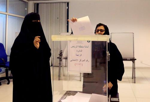 Saudi women vote at a polling center during the country's municipal elections in Riyadh, Saudi Arabia