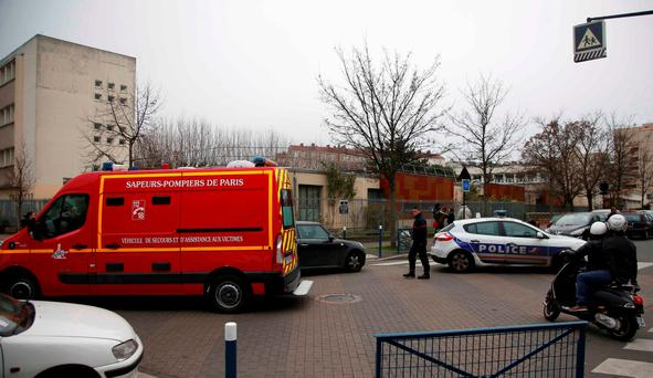 French police and firefighters are seen in front of the nursery school where a hooded man claiming to be acting for Islamic State attacked a teacher with a knife in Aubervilliers, near Paris, France, December 14, 2015