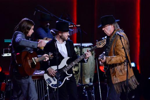 WASHINGTON, DC- NOVEMBER 18: Lukas Nelson (L) and Neil Young (R) perform during the 2015 Gershwin Prize Honoree's Tribute Concert Honoring Willie Nelson at DAR Constitution Hall in Washington DC on November 18, 2015. (Photo by Kris Connor/Getty Images)