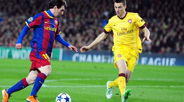 Old foes: Lionel Messi takes on Laurent Koscielny the last time Arsenal met Barcelona, in 2011