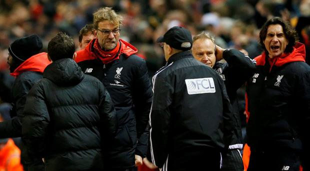 Liverpool manager Jurgen Klopp celebrates after Divock Origi (not pictured) scores their second goal as West Brom manager Tony Pulis looks on Action Images via Reuters / Carl Recine