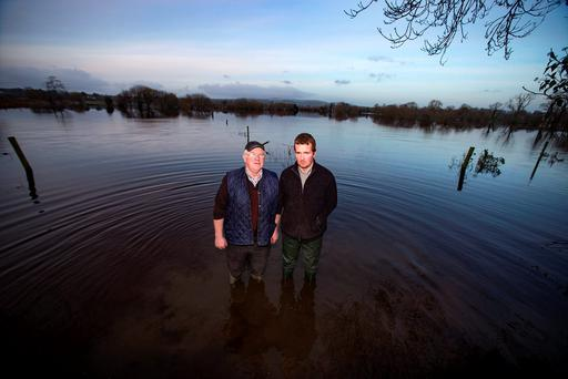 Farmers Brian Kileen (right) and Martin McMahon, ICMSA on flooded land at Clonlara, Co Clare. Photo: Arthur Carron