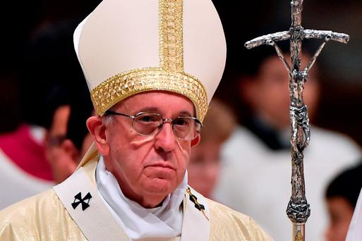 Pope Francis at a mass in St Peter's basilica in the Vatican Credit: GABRIEL BOUYS / AFP (Getty Images)