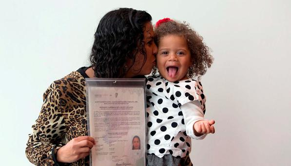 Graciele Souza, originally from Brazil but now living in Blanchardstown, Dublin, with daughter Ellen as she and her husband Edilson Souza received their citizenship. Photo: Gareth Chaney