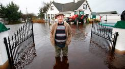Mick Dunning standing in the floodwaters around his home at Carrick O'Brien, Athlone.