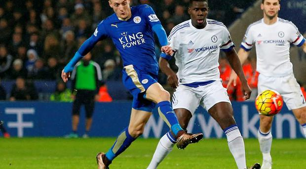 Jamie Vardy gets to the ball ahead of Kurt Zouma to put Leicester ahead against Chelsea