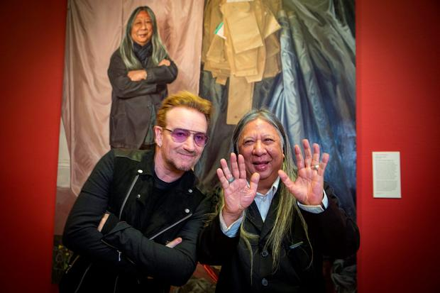 Bono and John Rocha at the unveiling of a portrait of the designer by artist Geraldine O'Neill at the National Gallery of Ireland in Dublin. Left, Ali Hewson. Photo: Arthur Carron.