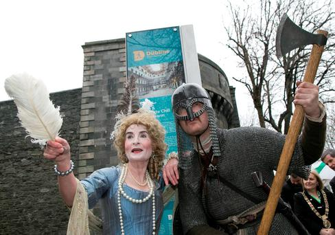 Viking Dublin character Dave Swift with Mary Ryan as Lady Lucy from Carton House at the official launch of the interpretive panels in Dublin yesterday. Photo: Colm Mahady
