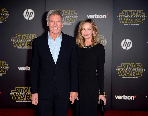 Actor Harrison Ford and his wife, actress Calista Flockhart, arrive at the premiere of