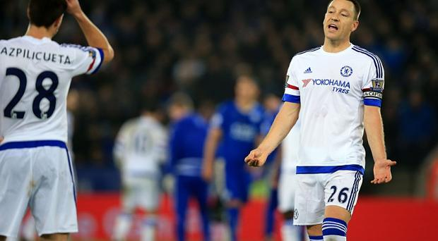 Chelsea's John Terry speaks with team-mate Chelsea's Cesar Azpilicueta during the Barclays Premier League match at The King Power Stadium