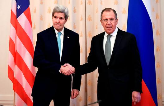 U.S. Secretary of State John Kerry (L) and Russian Foreign Minister Sergei Lavrov shake hands as they pose for cameras ahead of a bilateral meeting in Moscow December 15, 2015