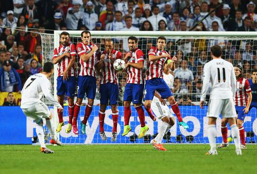 Cristiano Ronaldo shoots from a free kick