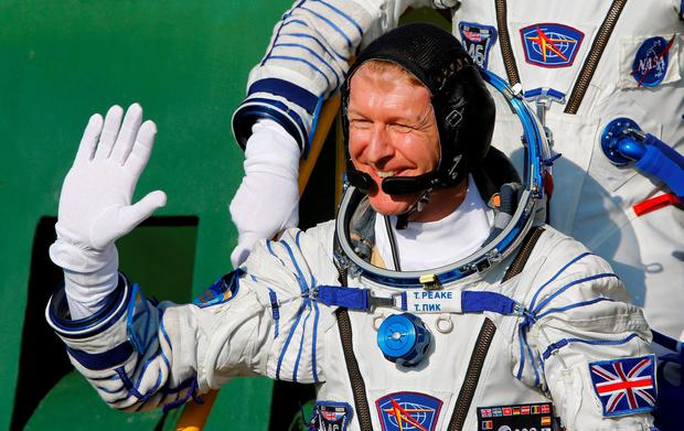 British astronaut Tim Peake, member of the main crew of the mission to the International Space Station (ISS), gestures, prior to the launch at the Russian leased Baikonur cosmodrome, Kazakhstan, Tuesday, Dec. 15, 2015