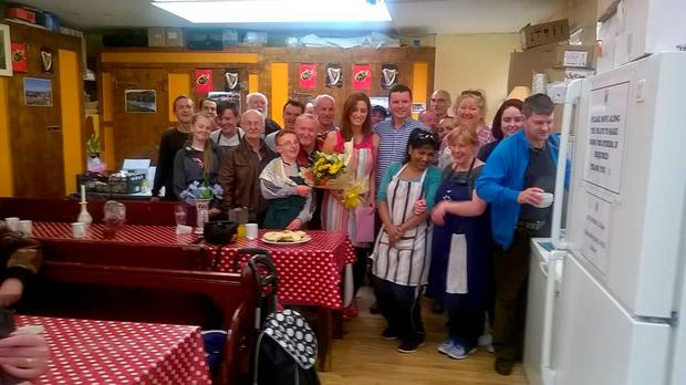 Just some of the Penny Dinner volunteers. Caitriona Twomey is pictured third from the right in the back. (Photo: Facebook/Cork Penny Dinners)