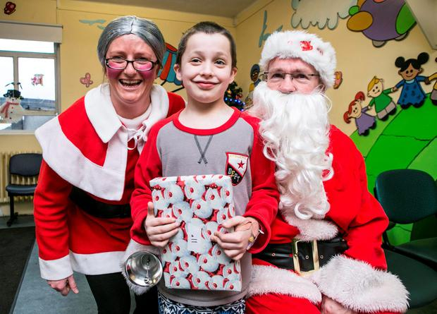 Santa and Mrs Claus with Oisin Slevin (9) from Borrisokane Co Tipperary during a Fun Day in Crumlin Childrens Hospital