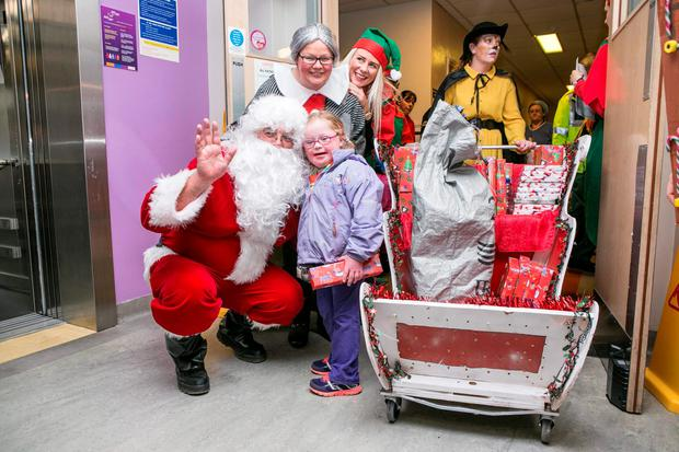 Santa with Ava Mc Grath (5) from Galway during a Fun Day in Crumlin Childrens Hospital