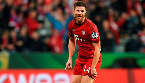 Bayern Munich's Spain defender Xavi Alonso celebrates the first goal during the German Cup DFB Pokal third round match between FC Bayern Munich and SV Darmstadt 98 in Munich