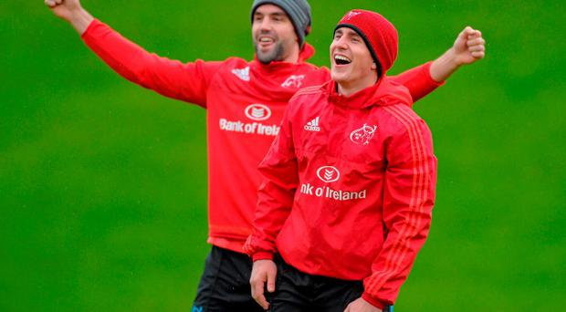 Ian Keatley and Conor Murray share a joke at the Munster training session in Limerick yesterday
