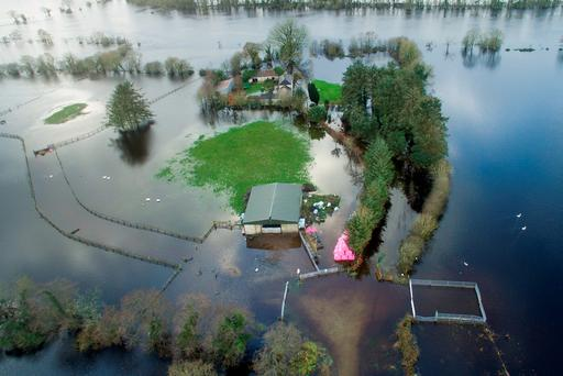 A farmhouse and buildings surrounded by floodwaters in Montpelier, Co. Limerick, earlier this week. Photo: Tisc
