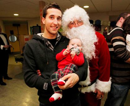 Colin Walsh with his daughter Amelia (6 months) at Our Lady's Hospital for Sick Children in Crumlin as Santa paid a very special visit to the young patients there. Photo: Stephen Collins
