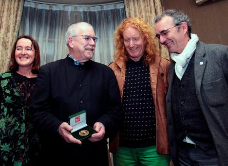 Poet Catherine Ann Cullen, artist Robert Ballagh, poet Louis de Paor and Prof Michael Cronin with medallion designed by Robert Ballagh at the launch of a competition to find new writing on the topic: 'The Vision of 1916: Yesterday, Today and Tomorrow'. Photo: Leah Farrell