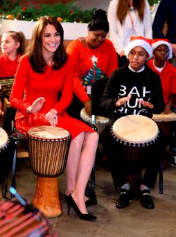 The Duchess of Cambridge takes part in some drumming 'music therapy' as she attends the Anna Freud Centre Family School Christmas Party at Anna Freud Centre. Photo: Getty Images