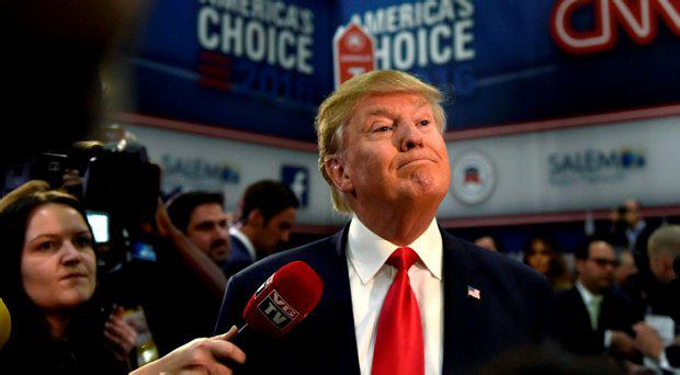 Republican U.S. presidential candidate and businessman Donald Trump speaks to the media in the spin room following the U.S. Republican presidential debate in Las Vegas