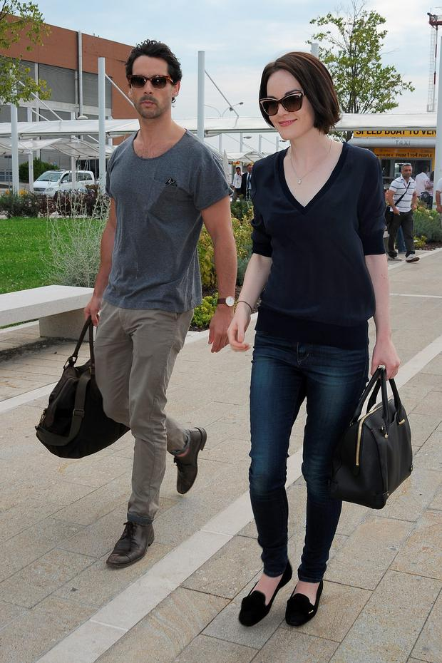 Michelle Dockery and John Patrick Dineen are seen leaving the Venice Airport during The 70th Venice International Film Festival on September 1, 2013 in Venice, Italy. (Photo by Jacopo Raule/FilmMagic)