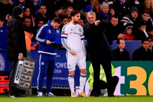Cesc Fabregas of Chelsea speaks with Jose Mourinho the manager of Chelsea as he prepares to come on as a substitue during the Barclays Premier League match between Leicester City and Chelsea at the King Power Stadium on Monday