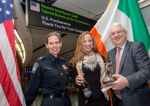 Pictured are US CBP Port Director at Dublin Airport, Tish Lagerwey; Philamena Linton,US CBP's one millionth passenger in 2015, and Dublin Airport Managing Director, Vincent Harrison.