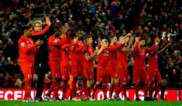 Liverpool manager Jurgen Klopp (second left) celebrates with his players after grabbing a late draw during the Barclays Premier League match at Anfield