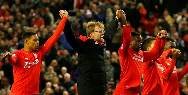 Liverpool manager Juergen Klopp celebrates his team after the game